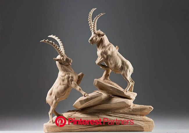 Rippling muscles, thick horns, and fur so realistic that you can almost feel the wind blowing through it—Guise… | Animal sculptures, Wooden sculpture,