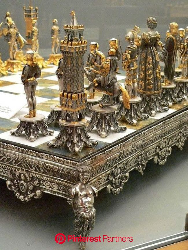 This Silvered and Gilded Bronze Vasari Figural Chess Set rests on a board of silver framed polished Italian onyx   Chess set, Chess, Chess board